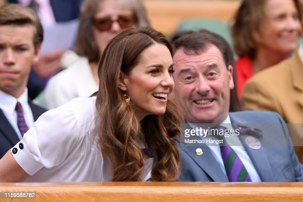 Catherine Duchess of Cambridge speaks to the Wimbledon Chairman Philip Brook in the royal box during Day two of The Championships Wimbledon 2019 at...