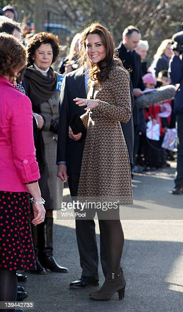 Catherine Duchess of Cambridge speaks to wellwishers as she arrives at Rose Hill Primary School to visit The Art Room facilities on February 21 2012...