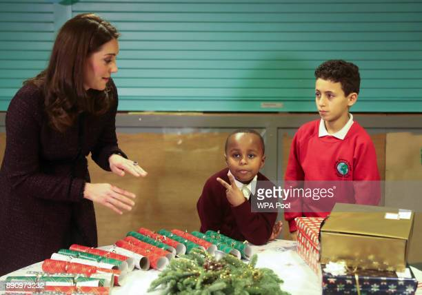 Catherine Duchess of Cambridge speaks to Yahya Hussein Ali 7 and Dawud Wahabi children affected by the Grenfell Tower fire at its community centre in...