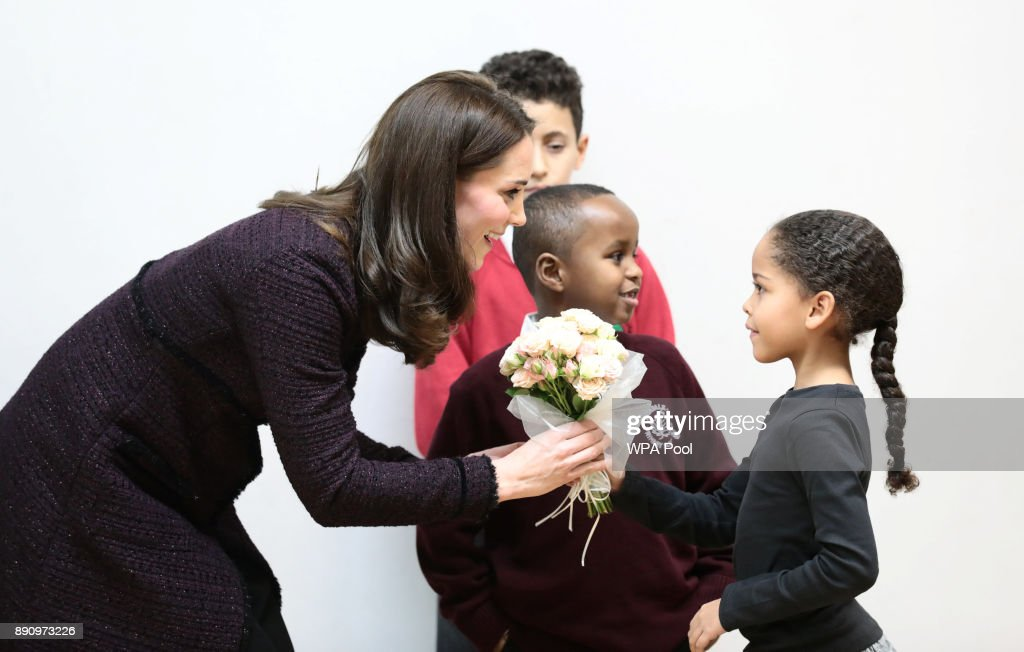 Catherine, Duchess of Cambridge speaks to Yahya Hussein Ali, 7, and Dawud Wahabi, 10, children affected by the Grenfell Tower fire, and Ailise Taylor, 7, at its community centre in North Kensington on December 12, 2017 in London United Kingdom.