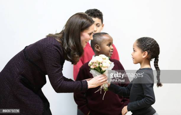 Catherine Duchess of Cambridge speaks to Yahya Hussein Ali and Dawud Wahabi children affected by the Grenfell Tower fire and Ailise Taylor at its...