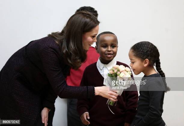 Catherine Duchess of Cambridge speaks to Yahya Hussein Ali and Dawud Wahabi children affected by the Grenfell Tower fire and Ailise Taylor during a...