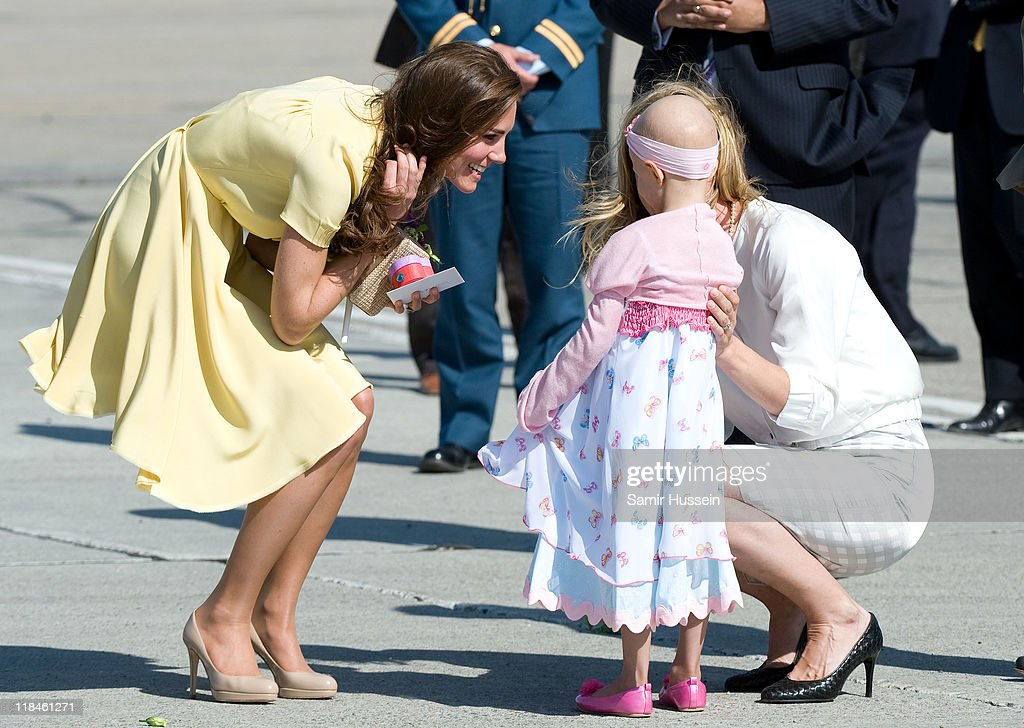 Catherine, Duchess of Cambridge speaks with 6 year old terminal cancer sufferer Diamond at Calgary Airport on day 8 of the Royal couple's tour of North America on July 7, 2011 in Calgary, Canada.