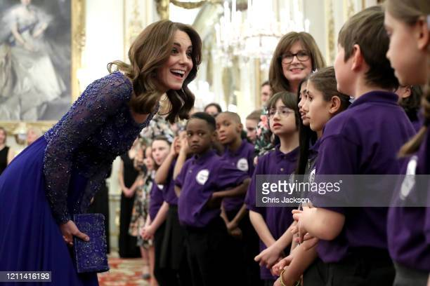 Catherine, Duchess of Cambridge speaks with a school choir as she hosts a Gala Dinner in celebration of the 25th anniversary of Place2Be at...