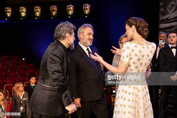 Catherine, Duchess of Cambridge speaks with Andy Serkis and BAFTA winner Sam Mendes at the EE British Academy Film Awards 2020 at Royal Albert Hall...