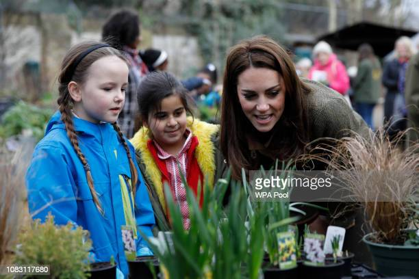 Catherine, Duchess of Cambridge speaks with children as she visits Islington Community Garden on January 15, 2019 in London, England.