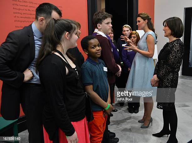 Catherine Duchess of Cambridge speaks with children during an evening reception to celebrate the work of The Art Room charity at The National...