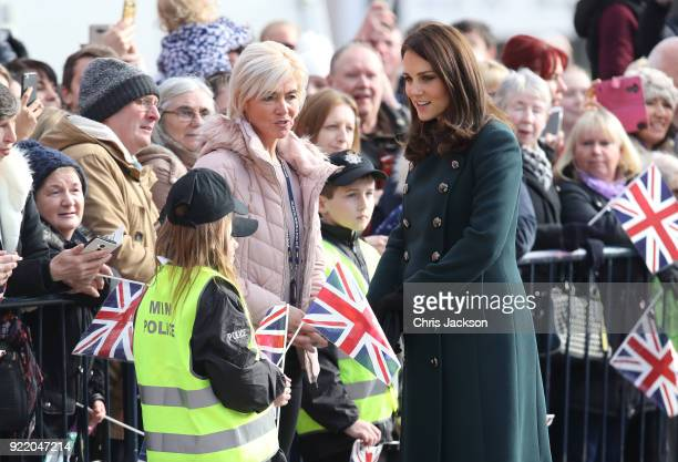 Catherine Duchess of Cambridge speaks with cildren dressed as Mini Police officers as she visits The Fire Station one of Sunderland's most iconic...