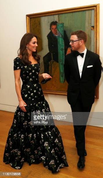 Catherine Duchess of Cambridge speaks with Dr Nicholas Cullinan Director of National Portrait Gallery as she attends the 2019 Portrait Gala at the...