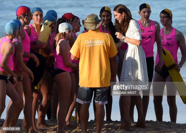 Catherine Duchess of Cambridge speaks with junior surf life savers at Manly beach on Sydney's north shore on April 18 2014 Britain's Prince William...
