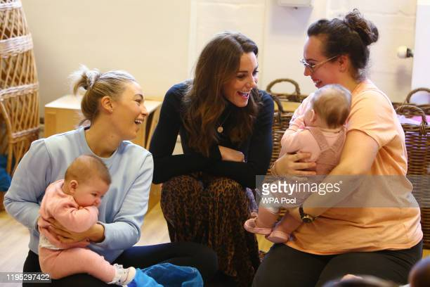 Catherine, Duchess of Cambridge speaks with parents during her visit to the Ely & Caerau Children's Centre on January 22, 2020 in Cardiff, Wales. The...