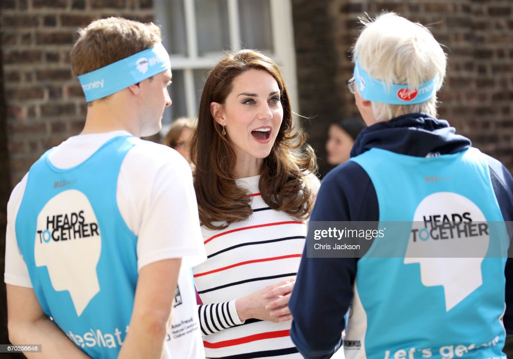 Catherine, Duchess of Cambridge speaks with runners from Team Heads Together ahead of the 2017 Virgin Money London Marathon, at Kensington Palace on April 19, 2017 in London, England. Heads Together is spearheaded by the Duke and Duchess of Cambridge and Prince Harry, in partnership with eight leading mental health charities that are tackling stigma, raising awareness, and providing vital help for people with mental health problems.