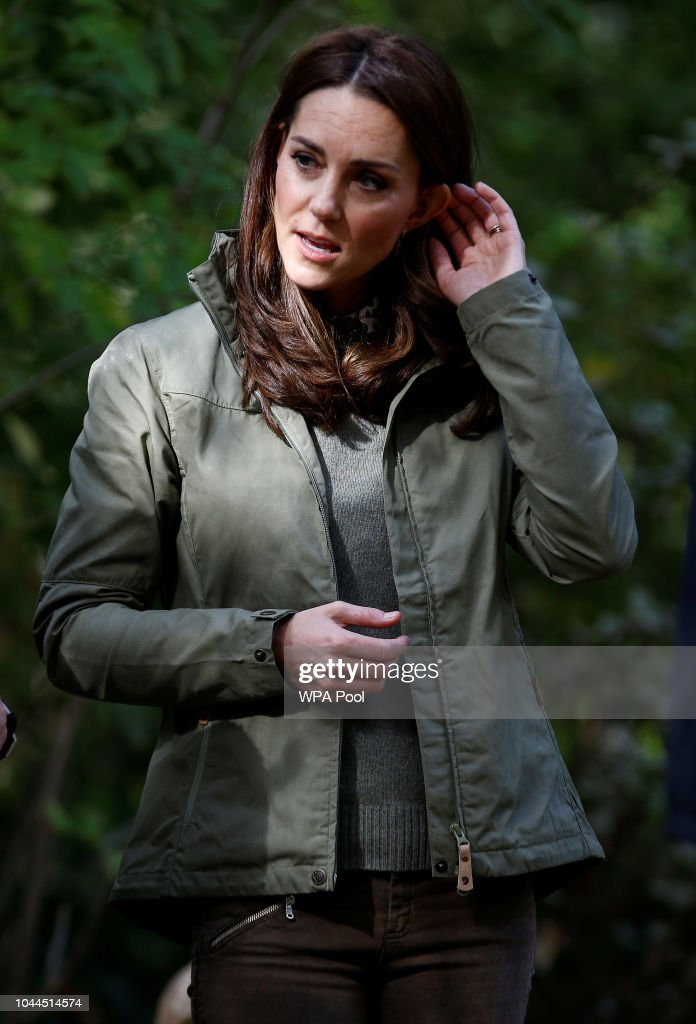 Catherine, Duchess Of Cambridge Speaks With Staff During A