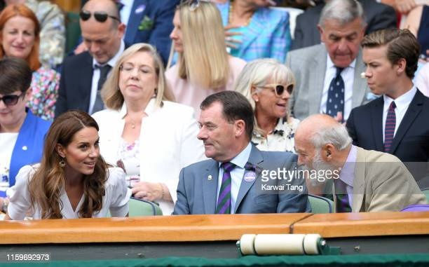 Catherine, Duchess of Cambridge speaks with Wimbledon Chairman Philip Brook and Prince Michael of Kent as she attends day two of the Wimbledon Tennis...