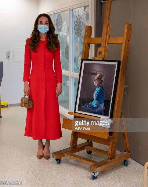 Catherine, Duchess of Cambridge stands next to an artwork during a visit to the Royal London Hospital Whitechapel on May 7, 2021 in London, England....