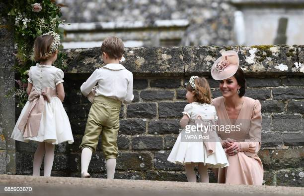 Catherine Duchess of Cambridge stands with her daughter Princess Charlotte of Cambridge a bridesmaid following the wedding of her sister Pippa...