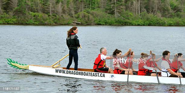Catherine Duchess of Cambridge steers a dragon boat before a race against her husband across the Dalvay lake on July 4 2011 in Charlottetown Canada...