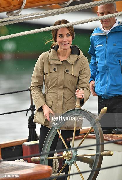 Catherine, Duchess of Cambridge steers the tall ship, Pacific Grace, before sailing with members of the Sail and Life Training Society at Victoria...