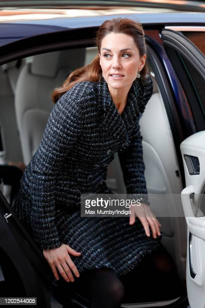 Catherine, Duchess of Cambridge steps out of her chauffeur driven Jaguar I-PACE electric car as she arrives to join a workshop run by the National...