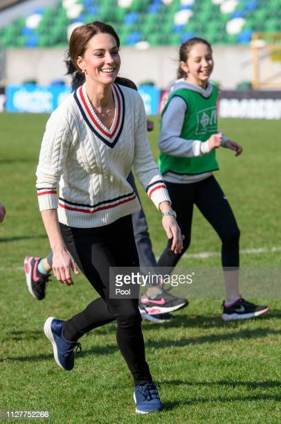 Catherine, Duchess of Cambridge takes part in a football training session with children during a visit the National Stadium in Belfast, home of the...