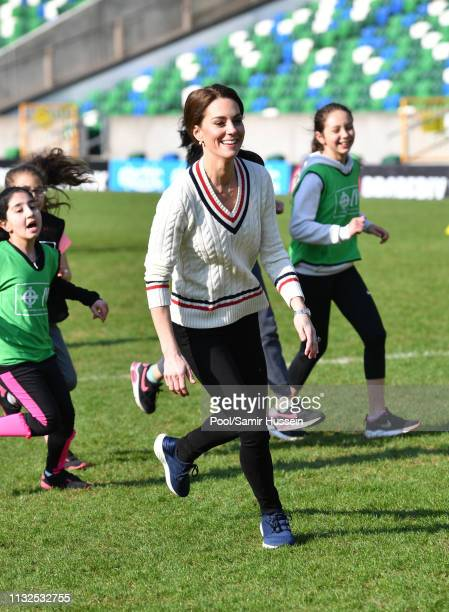 Catherine Duchess of Cambridge takes part in a football training session with children during a visit the National Stadium in Belfast home of the...