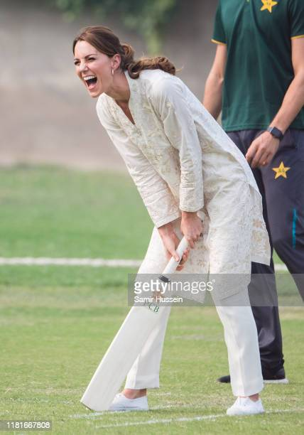 Catherine Duchess of Cambridge takes part in a game of cricket as she visits the National Cricket Academy in Lahore on October 17 2019 in Lahore...