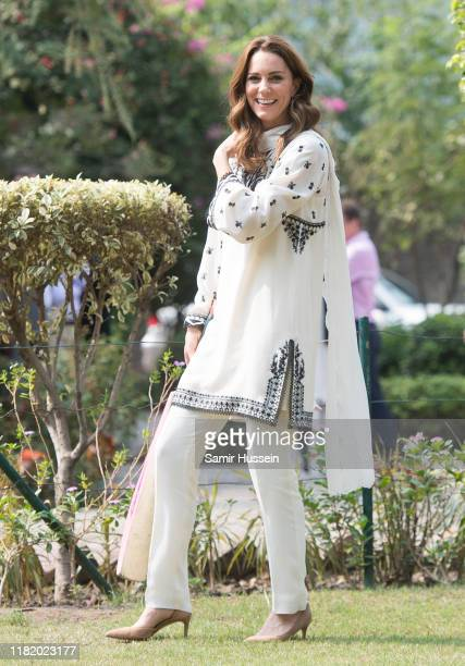 Catherine Duchess of Cambridge takes part in a game of cricket as she visits SOS Children's Village a charitable organisation in the heart of the...