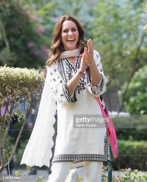 Catherine, Duchess of Cambridge takes part in a game of cricket as she visits SOS Children's Village, a charitable organisation in the heart of the...