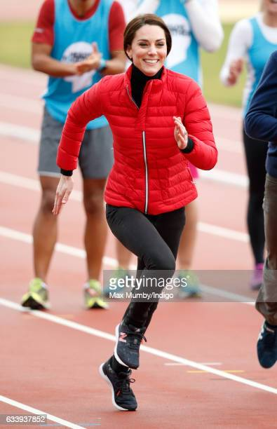Catherine, Duchess of Cambridge takes part in a running race against Prince William, Duke of Cambridge and Prince Harry as they join a Team Heads...