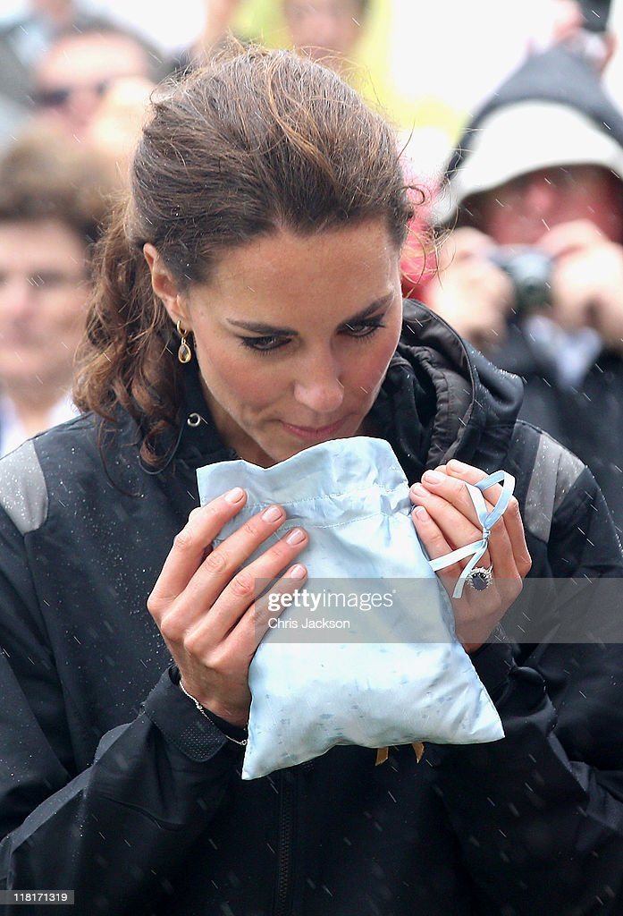 Catherine, Duchess of Cambridge takes part in a smudging ceremony as she arrives on shore after rowing dragon boats across Dalvay lake on July 4, 2011 in Charlottetown, Canada. The newly married Royal Couple are on the fifth day of their first joint overseas tour. The 12 day visit to North America is taking in some of the more remote areas of the country such as Prince Edward Island, Yellowknife and Calgary. The Royal couple started off their tour by joining millions of Canadians in taking part in Canada Day celebrations which mark Canada's 144th Birthday.