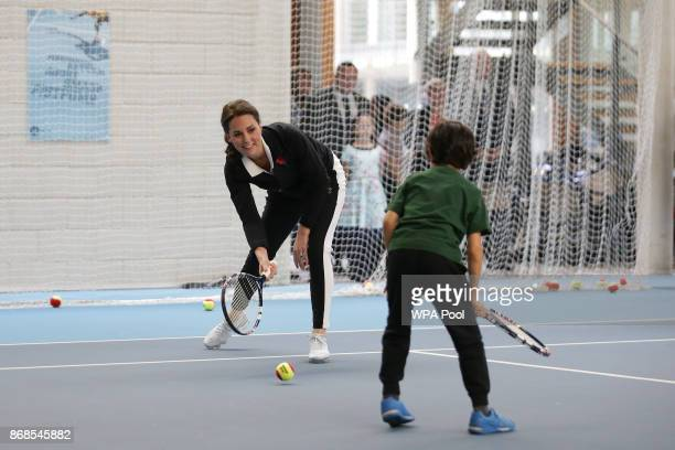 Catherine Duchess of Cambridge takes part in a Tennis for Kids session during a visit at the Lawn Tennis Association at the National Tennis Centre on...