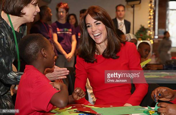 Catherine Duchess of Cambridge takes part in group activities as she attends the Anna Freud Centre Family School Christmas Party at Anna Freud Centre...