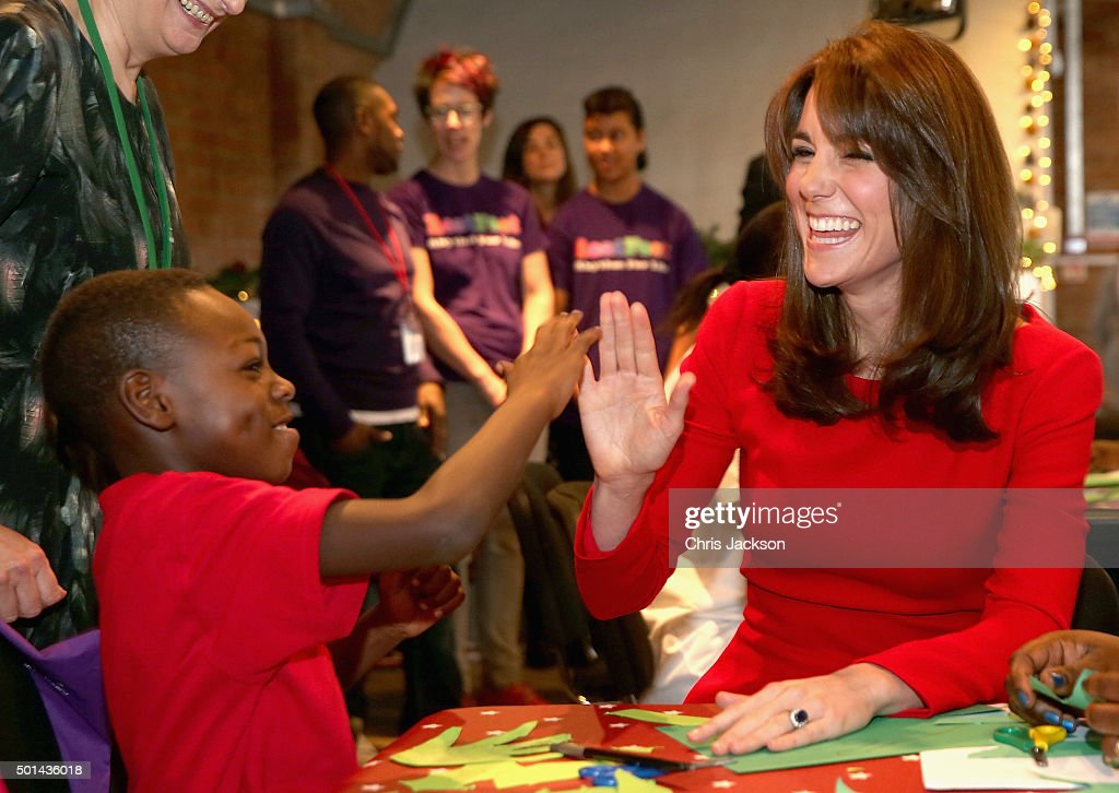 Catherine, Duchess of Cambridge takes part in group activities as she attends the Anna Freud Centre Family School Christmas Party at Anna Freud Centre on December 15, 2015 in London, England. The Duchess joined groups of families in Festive activities designed to help pupils reflect on the positive progress in their social relationships and communication skills.