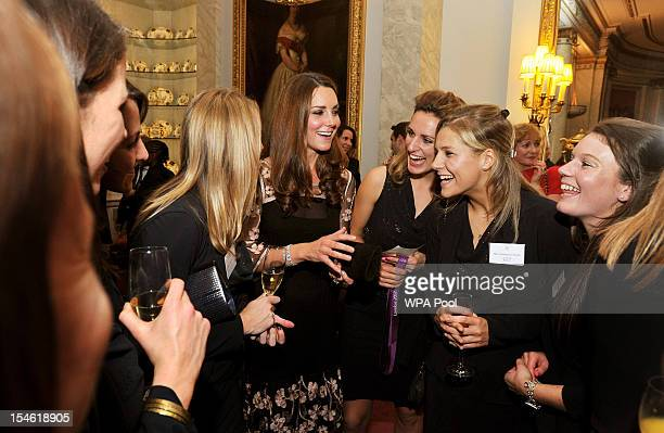 Catherine, Duchess of Cambridge talks the Women's hockey team during a reception held for Team GB Olympic and Paralympic London 2012 medalists at...