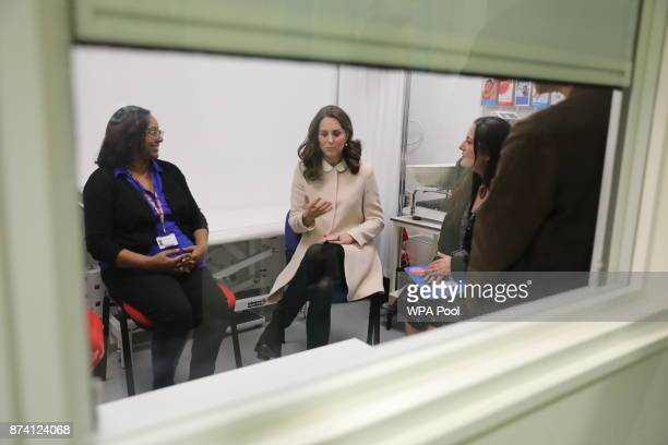 Catherine Duchess of Cambridge talks to antenatal staff in a private office at childrens centre as she visits the Hornsey Road Children's Centre on...