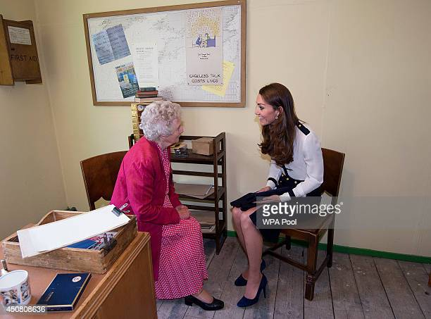 Catherine Duchess Of Cambridge talks to Bletchley veteran Lady Marion Body who knew her Grandmother during a tour the of the restored WWII...