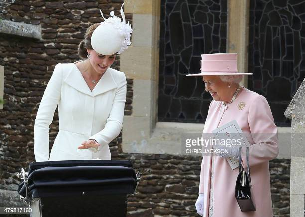Catherine, Duchess of Cambridge talks to Britain's Queen Elizabeth II after the christening of Princess Charlotte of Cambridge at St. Mary Magdalene...