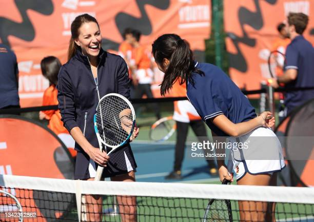 Catherine, Duchess of Cambridge talks to British US Open champion Emma Raducanu as they return to the LTA's National Tennis Centre for The Homecoming...
