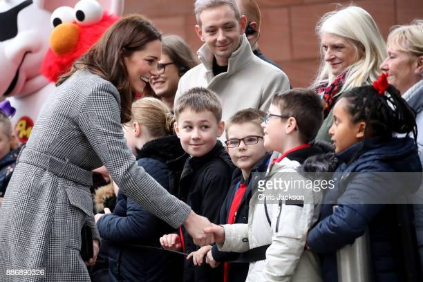 Catherine Duchess of Cambridge talks to children as she attends a 'Stepping Out' session at Media City on December 6 2017 in Manchester England The...