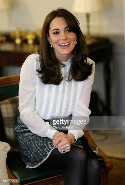 Catherine Duchess of Cambridge talks to children from the 'Real Truth' video blog that features on the Huffington Post website at Kensington Palace...