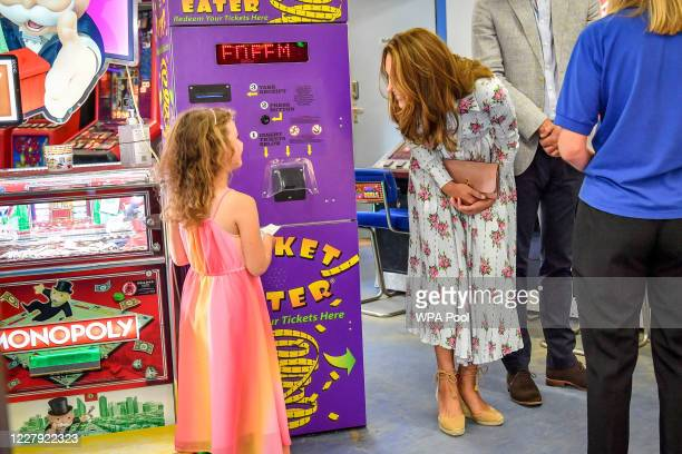 Catherine Duchess of Cambridge talks to Erin Phillips at Island Leisure Amusement Arcade where Gavin and Stacey was filmed during their visit to...