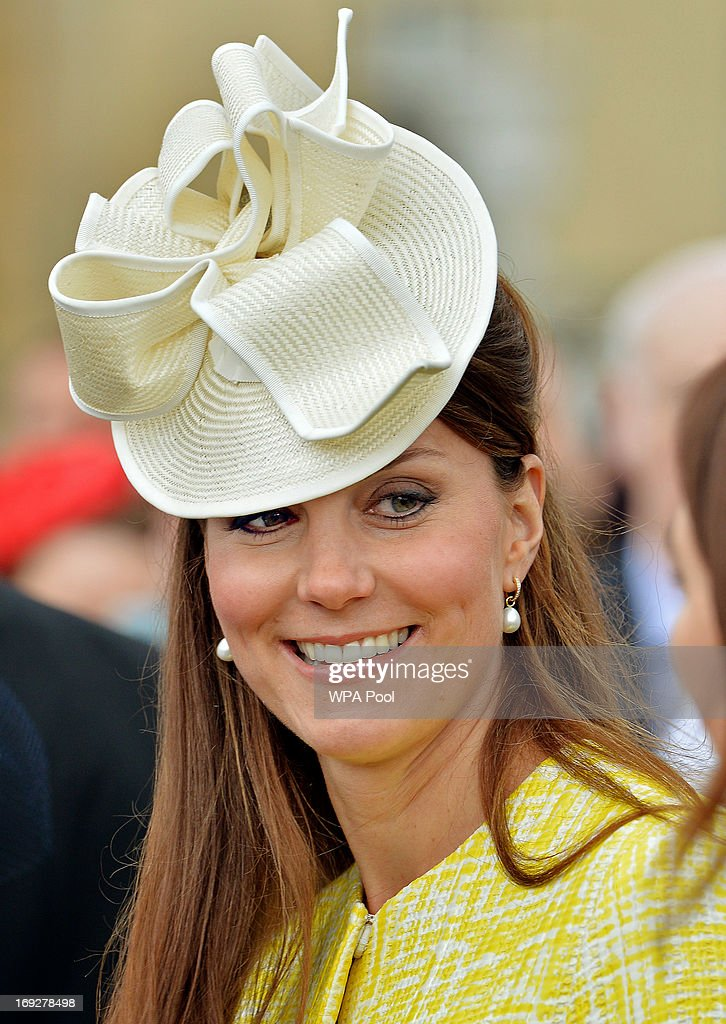 Catherine, Duchess of Cambridge talks to guests as she attends a Garden Party in the grounds of Buckingham Palace hosted by Queen Elizabeth II on May 22, 2013.