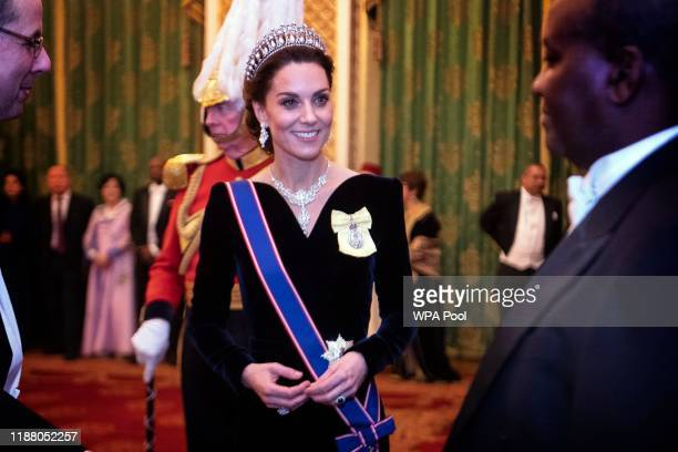 Catherine Duchess of Cambridge talks to guests at an evening reception for members of the Diplomatic Corps at Buckingham Palace on December 11 2019...