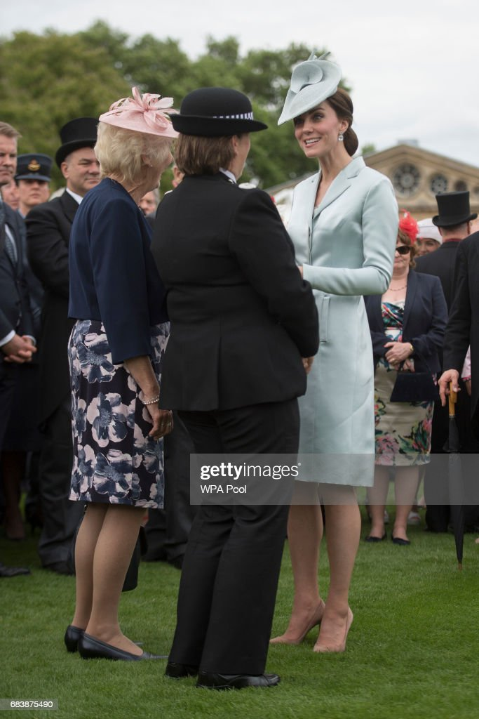 Catherine, Duchess of Cambridge talks to guests during a garden party at Buckingham Palace on May 16, 2017 in London, England.