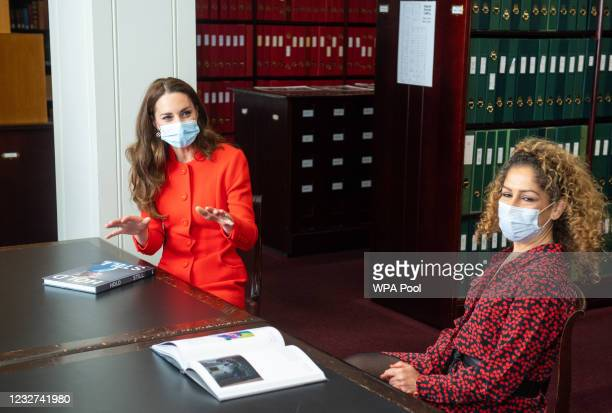 Catherine, Duchess of Cambridge talks to 'Hold Still' entrant Naz Maleknia during a visit to the archive in the National Portrait Gallery in central...