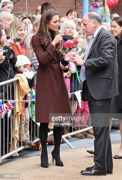 Catherine, Duchess of Cambridge talks to Jamie Lowther-Pinkerton as she visits Alder Hey Children's NHS Foundation Trust on February 14, 2012 in...