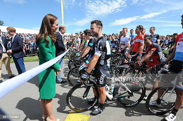 Catherine, Duchess of Cambridge talks to Mark Cavendish of Omega Pharma-Quick Step before the start of the start of the Tour de France on July 5,...