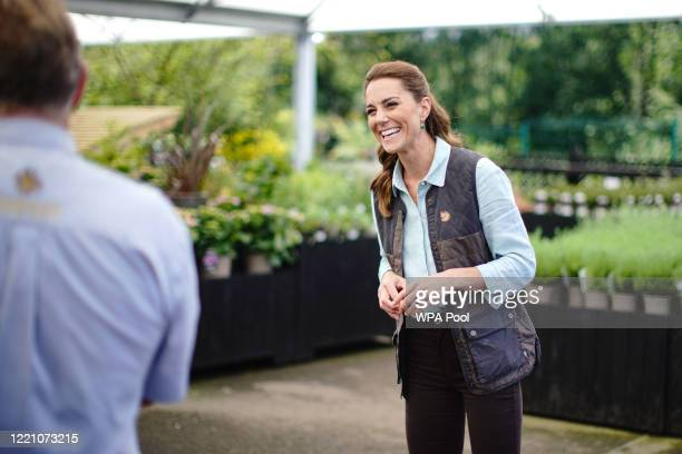 Catherine, Duchess of Cambridge talks to Martin and Jennie Turner, owners of the Fakenham Garden Centre in Norfolk, during her first public...