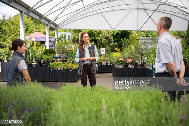 Catherine, Duchess of Cambridge talks to members of staff at Fakenham Garden Centre in Norfolk during her first public engagement since lockdown, on...