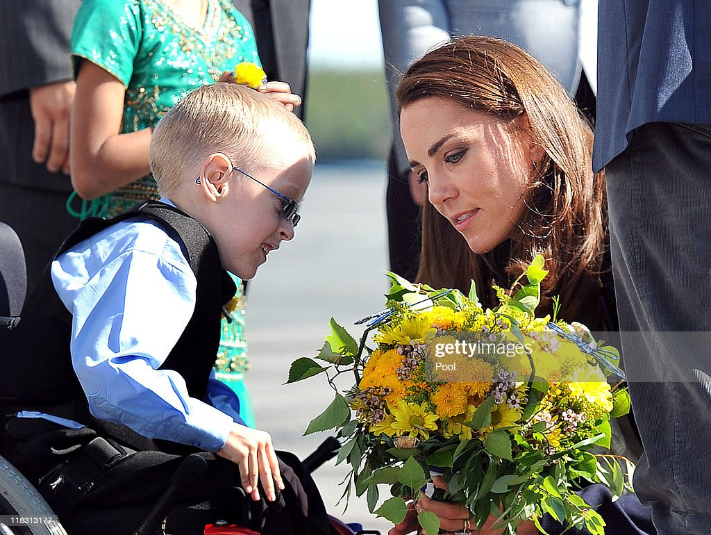 Catherine, Duchess of Cambridge talks to Riley Oldford, 6, before boarding a plane at Yellowknife Airport on July 6, 2011 in Yellowknife, Canada. The newly married Royal Couple are on the seventh day of their first joint overseas tour. The 12 day visit to North America is taking in some of the more remote areas of the country such as Prince Edward Island, Yellowknife and Calgary. The Royal couple started off their tour by joining millions of Canadians in taking part in Canada Day celebrations which mark Canada's 144th Birthday.